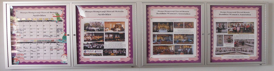 display case with Betsuin news and announcements (decorative banner)