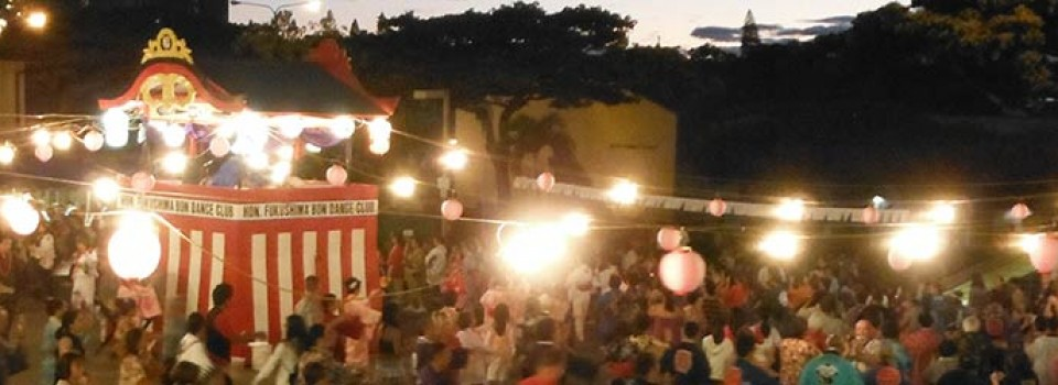 Obon dancers at Betsuin with yagura and lights at twilight