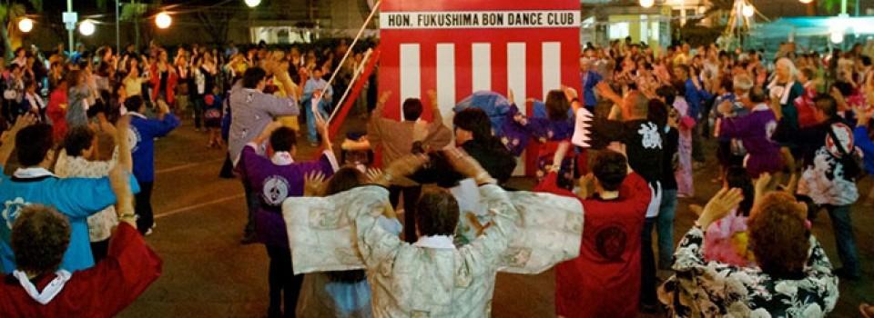 Bon dancers and the base of the yagura platform