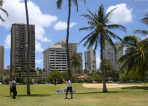 Golfers on sunny Ala Wai golf course