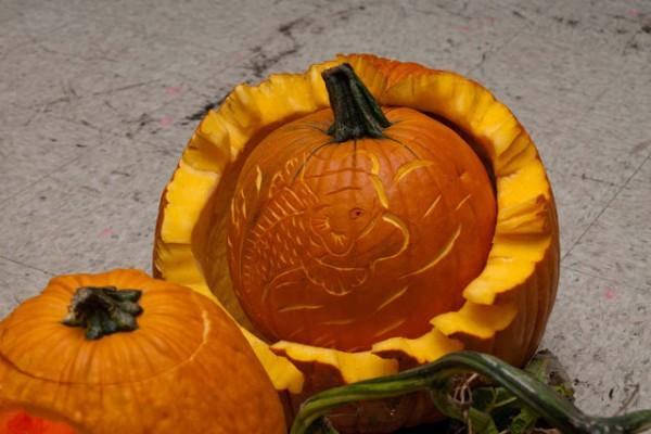 a pumpkin with a koi design inside another pumpkin