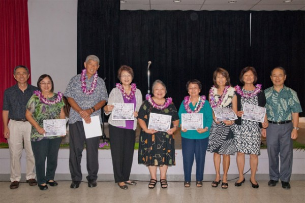 Seven Ashoka Award winners holding their certificates with Arthur Nakagawa and Rimban Muneto on either side.