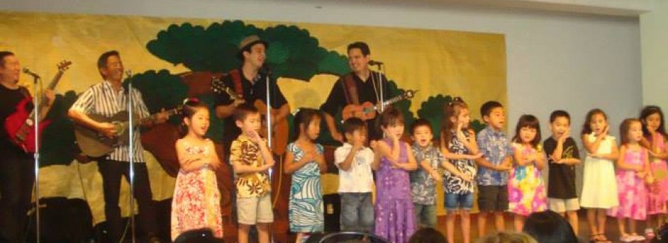 children and Manoa DNA on stage