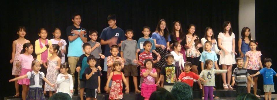 many children singing on stage