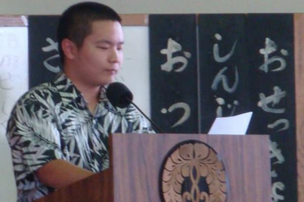 Dustin Iwasaki at the podium