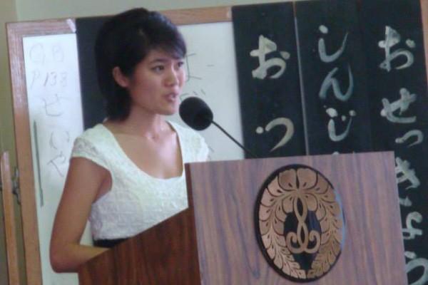 Lacy Tsutsuse at the podium