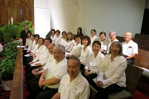 Betsuin choir all in white shirts, seated at Community Church
