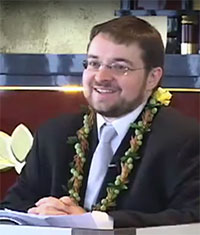 Dr. Jeff Wilson with lei at Hawaii Betsuin in 2011 delivering Futaba Memorial Lecture (video still from video by Wade Toyama)