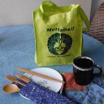 green Mottainai bag with sagarifuji, cup, napkin, small plate, and bamboo utensil set