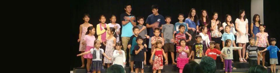 children and youth performing on the Social Hall stage