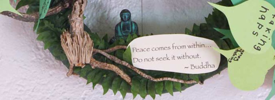 "wreath detail including quote, ""Peace comes from within. Do not seek it without."" - Buddha"