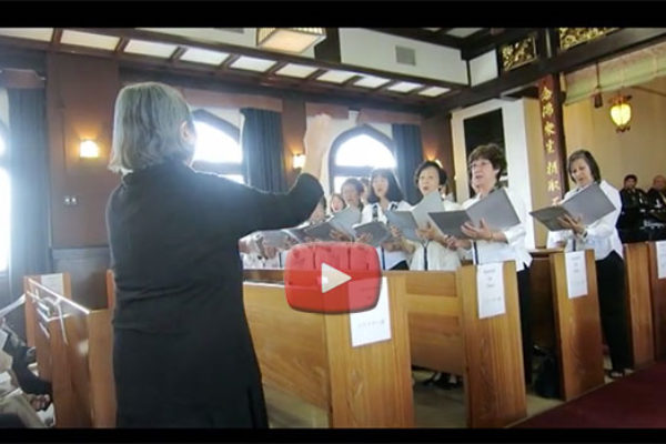 choir director conducts choir members a Jodo Mission