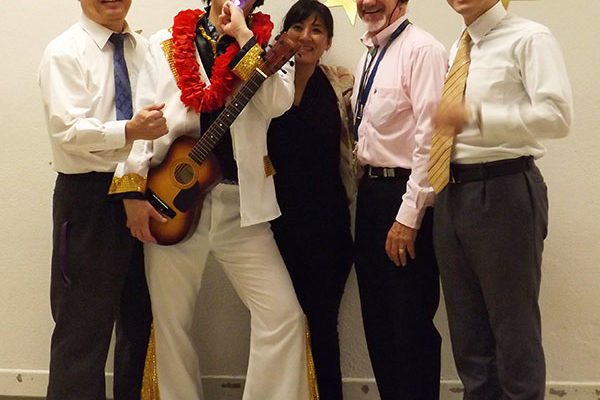 Five adults, four dressed as ministers and one as Elvis Presley