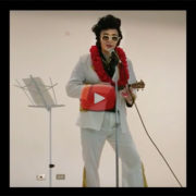 "video still of ""Elvis Sensei"" on stage at Betsuin social hall"