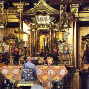 Rimban Hagio, seated, faces the altar which has been prepared for Hoonko (Shinran Shonin Memorial)