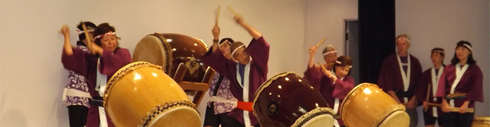 taiko players and drums in action on Social Hall stage
