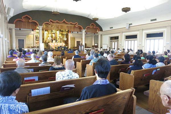 looking toward the altar over pews with attendees