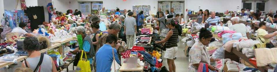 social hall filled with rummage sale and shoppers