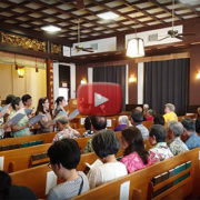 "video still of choir's performance of ""Refuge"" at HBC Buddha Day Service 2017"