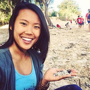 Doorae Shin at a beach cleanup