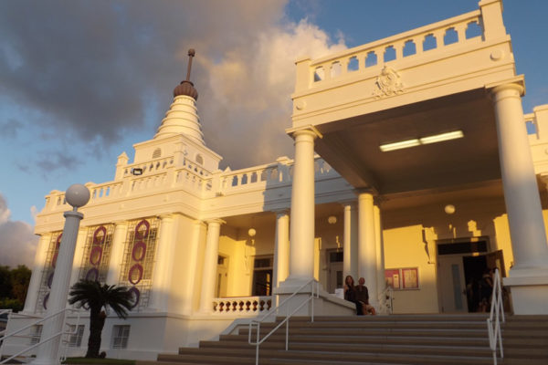 temple visitors on the steps with evening light on Hawaii Betsuin