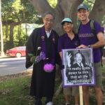 """Martin Luther King Jr. Parade 2018 - Bishop Matsumoto with Penny and David Atcheson with MLK photo and quotation, """"It all boils down to this: that all life is interrelated."""""""