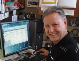 Stan Michaels at desk computer
